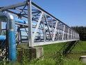 Most přes Moravu s produktovodem v Kroměříži mezi mostem dálničním a horním železničním.